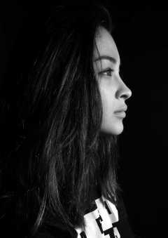 portrait of a girl with black background - face shot